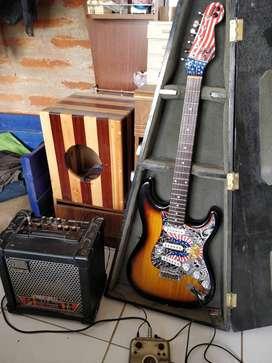 Guitarra electrica tipo Fender Nashville.  Amplificador de guitarra  Roland Cube  15 XL . Pedalera zoom G1N ext .3 años