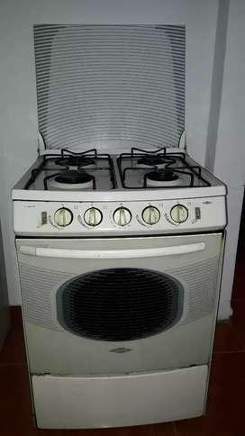Vendo estufa  a gas natural  usada con horno