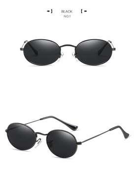 Lentes de sol negros estilo Lennon ovalados UV400