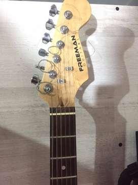 Guitarra eléctrica usada