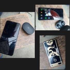 telefono Xiaomi estado 9,5/10 con airbuds basic 2