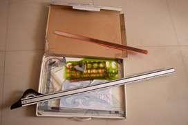 Tablero de dibujo técnico y varios accesorios