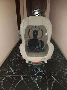 Coche, asiento de bebe para carro y canguro