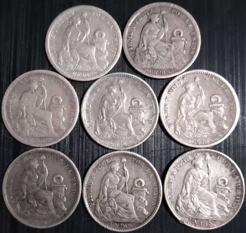 Monedas 1 dino plata 9 decimos 0