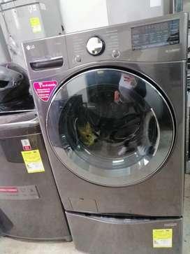 Remate lavadora secadora carga frontal con twinwash de 44 libras marca LG de exhibición de almacenes