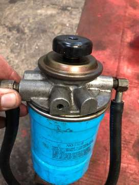 Porta filtro y filtro de gasoil nissan