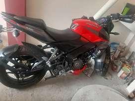 Vendo moto BAJAJ color rojo plomo