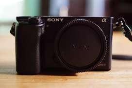Sony A6000 + 18-55 OSS + 55-210 OSS.