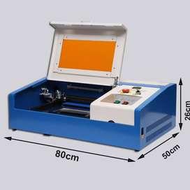 Máquina MINI Cnc Láser CO2 50W 3020 con controlador M2 para Corte y grabado de MDF, acrilico, cuero. Enfriamiento con mi