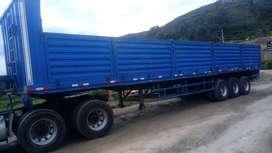 Carreta rebatible de 13 metros de largo del 2011 con llantas seminuevas bien conservado