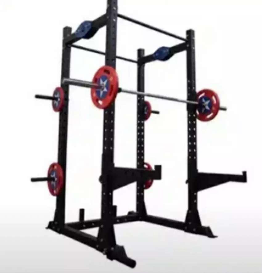 Jaula rack multifuncional pesas barra fondos dominadas