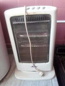 Vendo   una    estufa    electrica    movil    de    5   funciones