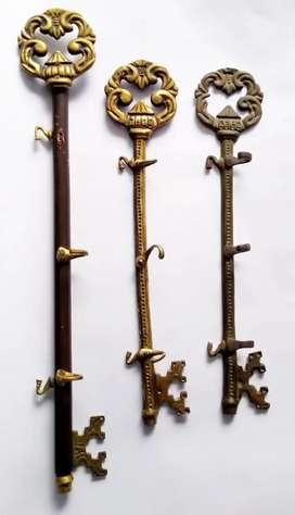 Juego de 3 percheros en madera y bronce, decoración.