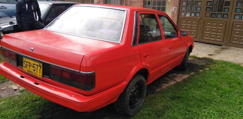 vendo mazda 323 modelo 1991,recibo moto 4.500.000 0