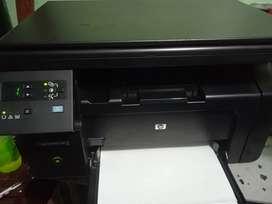 Impresora láser multifuncional blanco y negro HP m1132