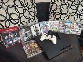 PS3 Slim con 2 controles y leliculas