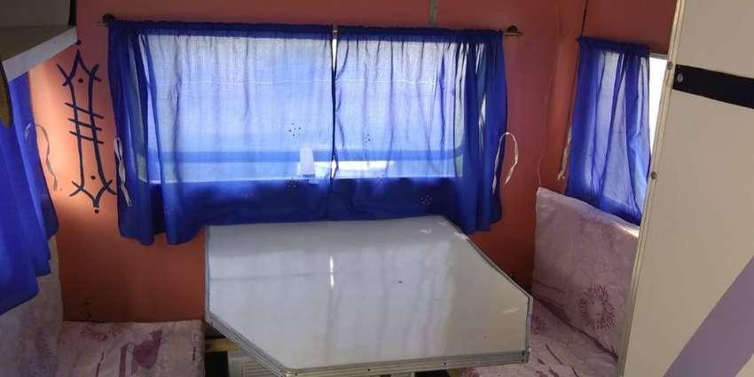 Vendo casa rodante con baño camas heladera aire mesa cosina todoooo 0