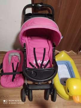 Coche infanti con silla para auto + tina inflable