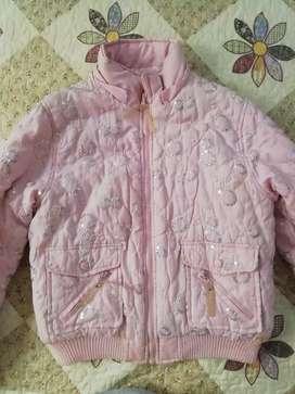 Linda chaqueta para niña forrada con detalles tornasol