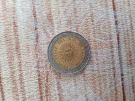 Moneda de 1 peso con error en la g len vez decir provincias dice provingias