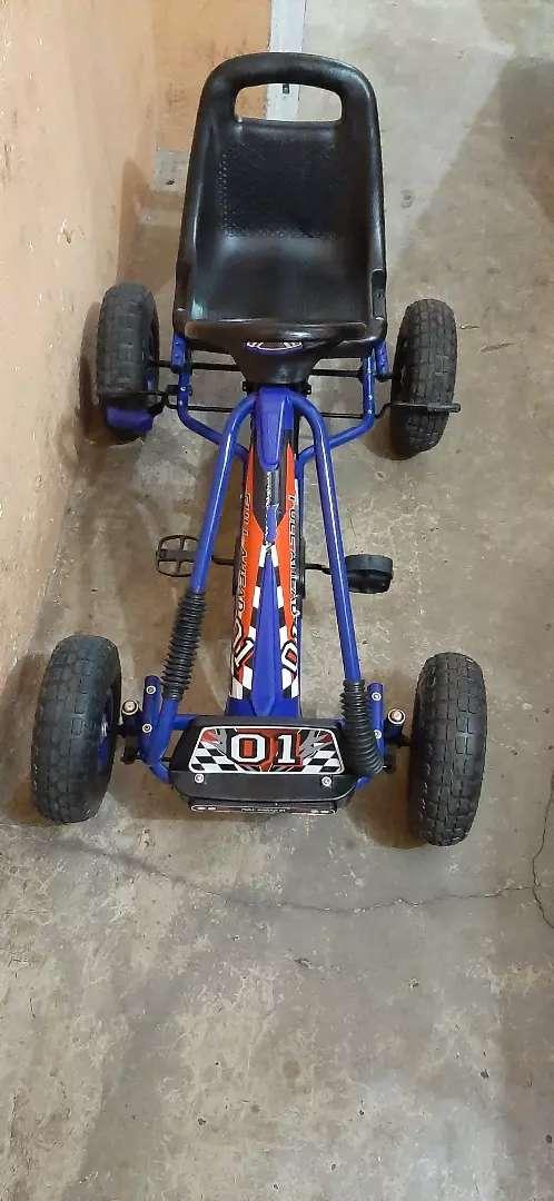 Triciclo a pedal para niño 0