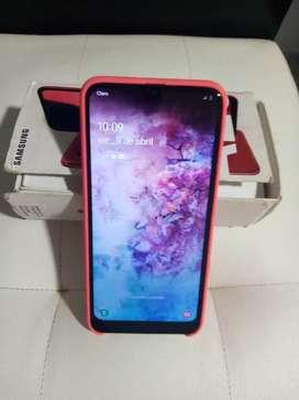 A20 con caja original 3de ram excelente estado doble SIM con forro silicón case color rojo