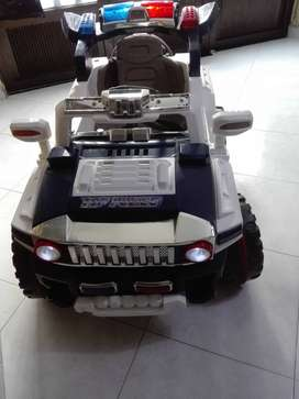 Hammer policia para niño eléctrico con bateria