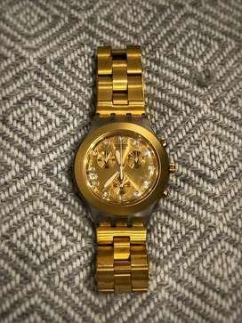Swatch dorado original.  Muy poco uso, perfecto estado.