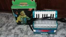 Vendo mini acordeon