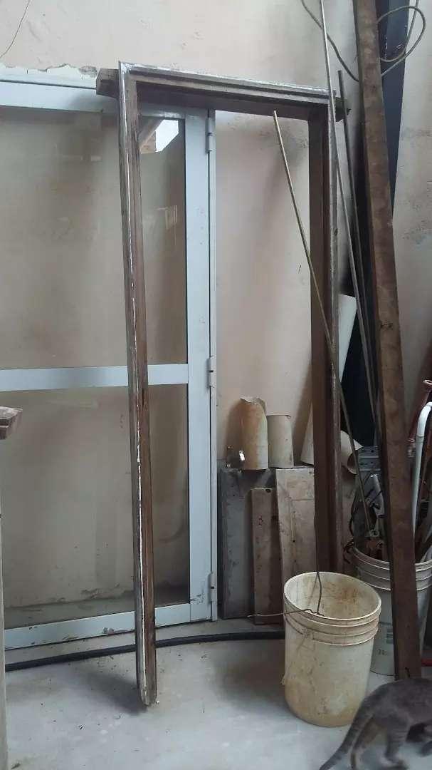 Vendo marco de puerta placa de madera dura 0