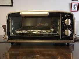 Horno tostador compacto Oster® negro 10 litros