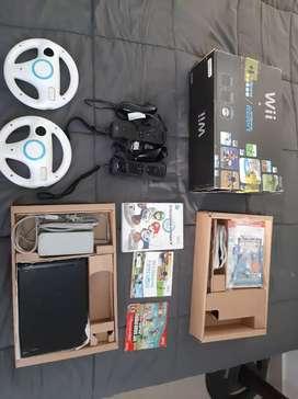 Nintendo Wii negro cons dos controles, dos volantes y 3 juegos