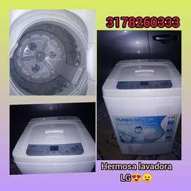 Hermosa lavadora LG en perfecto estado