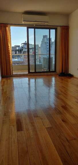 Departamento 2 habitaciones, 1 baño, cocina, comedor y balcón en barrio de Almagro, seguridad y salón usos múltiples