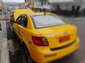 Se vende Taxi con puesto de cooperativa La Universitaria Manta