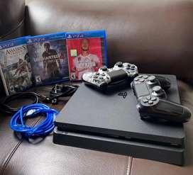 PS4 slim de 1tb, 2 controles y 3 juegos