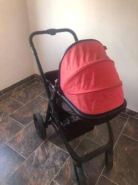 Coche rosado con negro marca maxibaby incluye silla para el carro