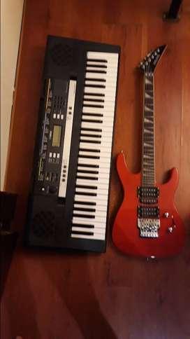 Teclado Yamaha psr-E243 y guitarra electrica Long Xing