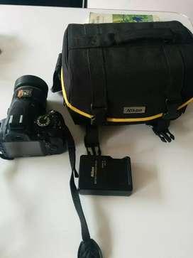 Camara profesional Nikon D3100 Lente 18-55