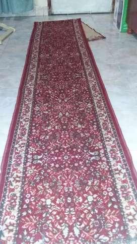 Alfombra persa usada