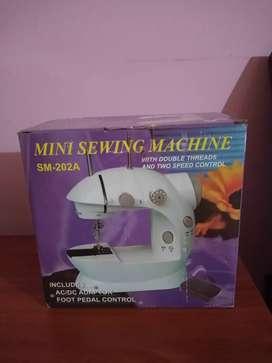 Mini máquina de coser Marca Sewin Machine