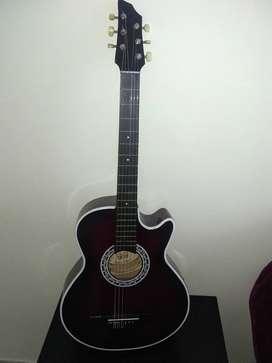 Vendo hermosa guitarra.