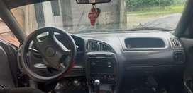 El carro está sanito es,el Chevrolet ESTEEM 4DLR  tiene vidrios eléctricos alarma todo completito