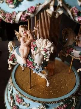 Carrusel caja musical de cupido