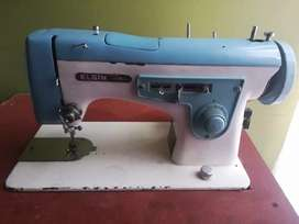 Maquina de coser familiar marca elgin