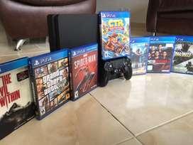 PS4 slim 500Gb + 7 juegos - NEGOCIABLES