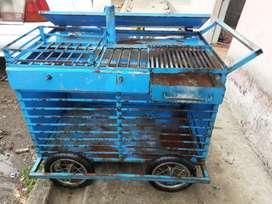 Vendo carretilla con ruedas dos hornillas parrilla con cajon para asar carnes chuzo lo q sea