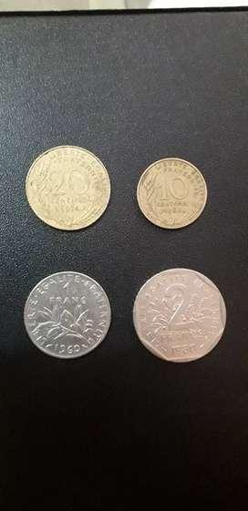 Vendo 5 monedas o cambio por billetes antiguos