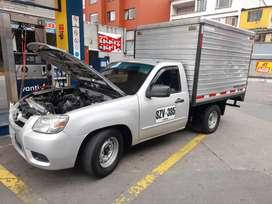 Alquilo mazda con furgon aislado