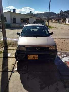 Carro Chevrolet alto en buen estado llantas nuevas  rines de lujo